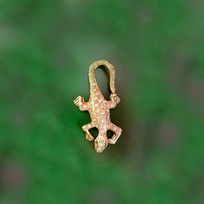 crocodile pendant with emerald colored eyes - In ancient Egyptian the crocodile was known as a symbol of power.